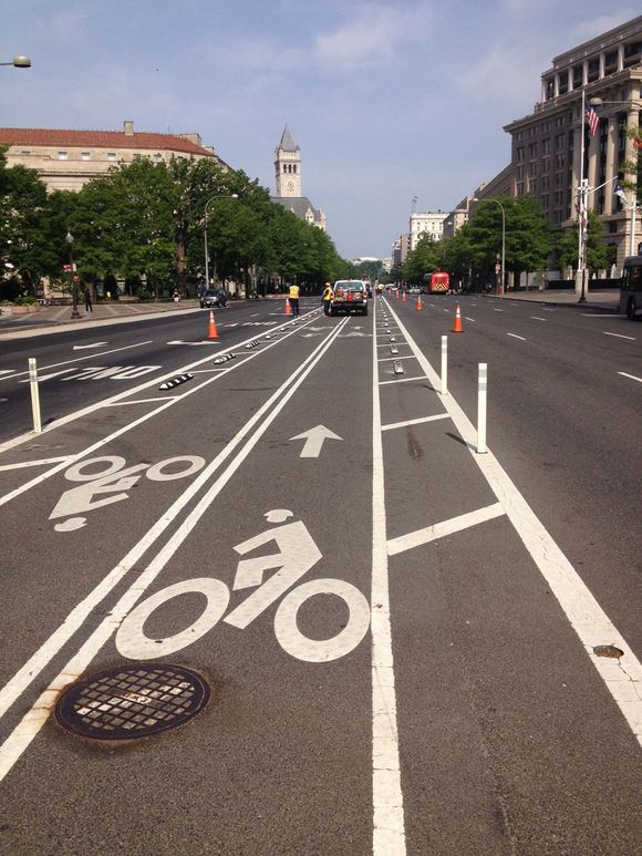 Barriers being installed on penn ave bike lanes (live)